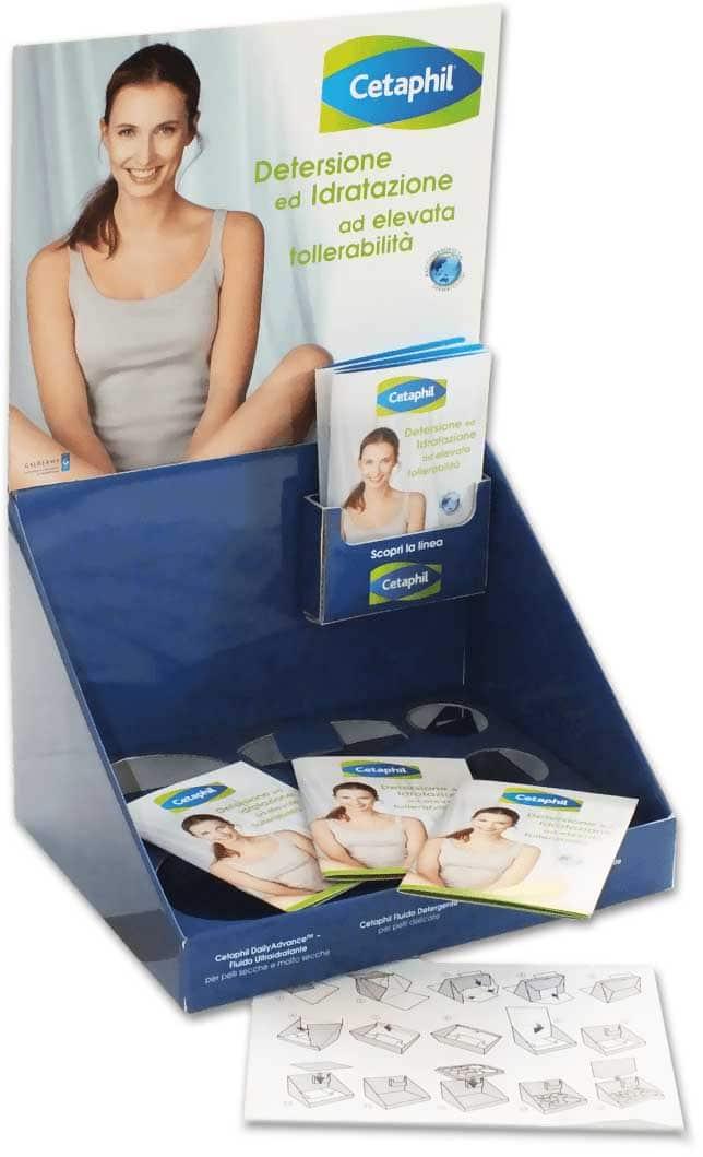 Espositore da banco in cartone, con base per scatole prodotto e tasca leaflet laterale